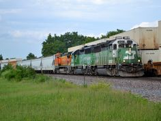 https://flic.kr/p/uLRP9U | A very green 102 | A pair of BN painted GP50s and a Dash 8 depart Joliet, IL with the 102 local.