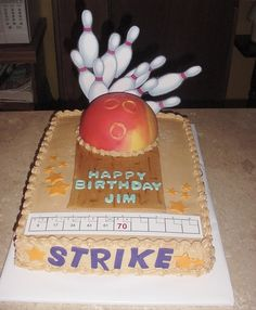 The bowling ball is fondant covered and the pins and score sheet are laminated paper, all else is b/c with fondant accents