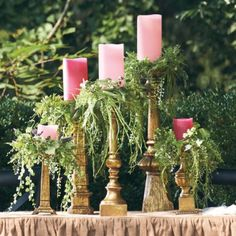 Cute idea to use the greenery around the top of candlesticks.