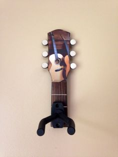 Store or display your guitar, mandolin, ukelele, etc. in style with this guitar wall hook made out of a repurposed guitar headstock. For more hooks with different images or more amazing music art at www.musicasartbysarah.etsy.com