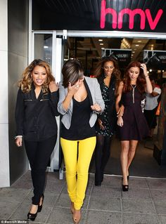 Hard day's work: The pop stars leave the store after meeting their adoring fans
