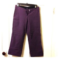 Prana Capris Only worn a few times, never put in the dryer, in great condition. Gorgeous eggplant purple capri length pants for yoga, hiking or just casual wear. The fabric (96% nylon, 4% spandex) is moisture wicking, quick drying and has quite a bit of stretch to it. They have a drawstring waist, 2 side slit pockets and a 4 inch slit up the side of each leg. They measure 30 inches top to bottom, 23 inch inseam and 15 inches across the top laying flat. Made in the USA! prAna Pants Capris