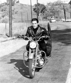 Vintage motorcycles Elvis Presley. I like the way he carried his guitar.