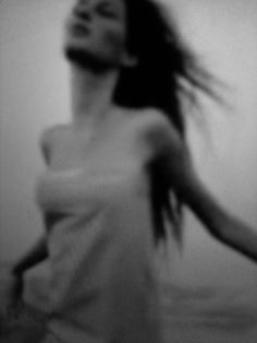 blurry . black and white photography . woman