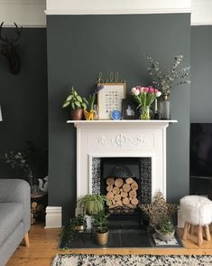 Dark Grey Walls with White Fireplace and Wooden Flooring Dark Living Rooms, Living Room With Fireplace, My Living Room, Interior Design Living Room, Home And Living, Living Room Designs, Living Room Decor, Dark Grey Dining Room, Living Room Wall Colours