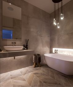 Luxury Bathroom Design with Ochre Lighting by Janey Butler Interiors
