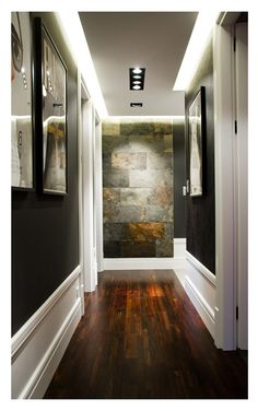 love the wall color, dropped panel lighting on ceiling, the stone accent wall and the rich warm wood floor