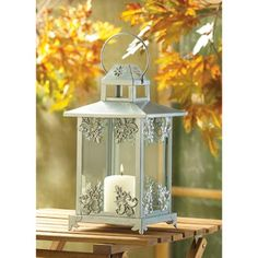 Silver Scrollwork Candle Lantern from Koehlerhomedecor.com - Gleaming silver finish and graceful scrollwork lend old-fashioned opulence to a classic candle lantern. An elegant decoration to enjoy, night and day! Also makes an artistic display for your favorite small houseplant or miniature figurine.  Buy wholesale at Koehler Home Décor.