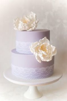 soft purple with lace and ivory flowers wedding cake