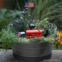A banner of patriotic pennants to decorate the miniature garden for the of July. Metal penannts are painted in alternating blue with white stars and red and white stripes. Hang a set from a flag, decorate a garden fence, or drape along the front edg Garden Terrarium, Terrariums, Garden Inspiration, Garden Ideas, Pennant Banners, Red And White Stripes, Summer Garden, Fairy Gardens, Fourth Of July