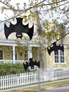 These black bats can be created with craft foam, googly eyes, and fishing line.