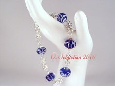 $55.00. Cobalt blue lampwork beads with sterling silver - one of my best bracelets ever! Available with other colors of lampwork beads upon request.