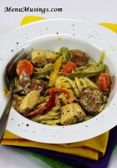Mardi Gras Pasta - This is one of our family's favorites!  Chicken, smoky sausage and tons of veggies in a creamy spiced up Alfredo sauce and fettuccine.  Step-by-step pictures.