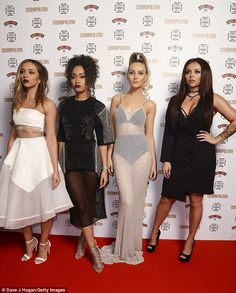 All dolled up: (From left) Jade, Leigh-Anne, Perrie Edwards and Jesy put on their best pou...