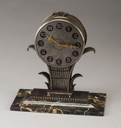 Edgar Brandt (1880-1926), Wrought Iron and Marble Table Clock.