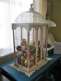 Ornaments in a birdcage. Kinda cute.  Could also do this with Easter eggs.