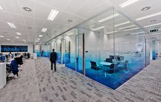 CMC offices in the City. Perfectly fluid graduated graphics, produced on optically clear with anti scratch laminate, were installed to glass panels throughout their offices.