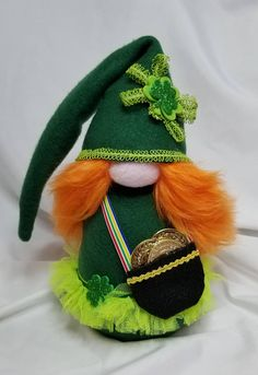 The luck of the Irish be with you! Lindsey Leprechaun has treasure to share! She is 10 inches tall and made of all new materials including fleece, trim, felt, foam shamrocks, plastic coins, faux fur, polyester fiberfill, rice for a weighted base and of course, love! All gnomes are