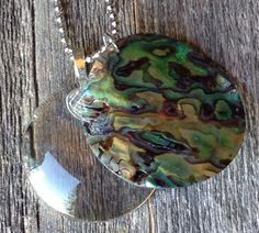 $18  Magnifying Glass Necklace/Come to my shop... A personal favorite from my Etsy shop https://www.etsy.com/listing/285447113/abalone-shell-magnifying-glass-necklace