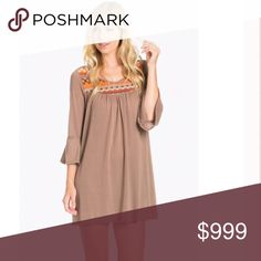 Embroidered Detail Bell Sleeve Dress in Mocha Embroidered neck detail. Beautiful Bell Sleeve Dress in Mocha. Soft, tightly woven sweater knit. Stretchy. Very comfortable. Looks great with leggings and boots. Can also wear a belt with it for another look. Made in the USA. 97% Cotton 3% Spandex. Price firm unless bundled The Blossom Apparel Dresses Mini