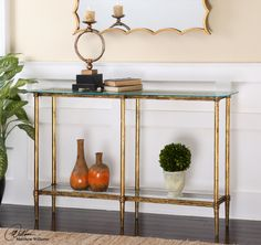 Gold leaf console with tempered glass top  54 W X 32 H