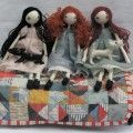 3 dolls on a bed - Sarah Strachan