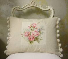 pillow with floral inset and pom pom fringe