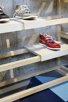 Shoe display shelf. can also be used for caps, backpacks??
