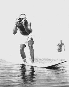 1969, LeRoy Grannis surfing Hermosa Beach with his Calypso amphibious camera, invented by another aquatic legend– Jacques Cousteau. Photo by John Grannis