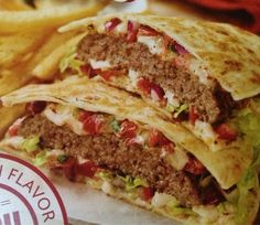 My hubby has a birthday VERY soon, and he has requested that I sometimes splurge and make 'unhealthy' meals. He LOVES quesadilla burgers. So, here's to a happy birthday!! -- Applebee's Copycat Recipes: Quesadilla Burger