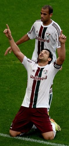 Fluminense - Brasileirao Series A 2014 In This Photo: Fred, Carlinhos Fred (front) and Carlinhos of Fluminense celebrate a scored goal during a match between Flamengo and Fluminense as part of Brasileirao Series A 2014 at Maracana Stadium on September 21, 2014 in Rio de Janeiro, Brazil.