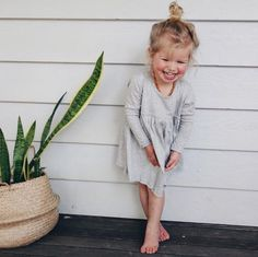 Cutest dress and topknot and smile