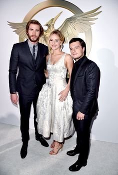 Jennifer Lawrence, Josh Hutcherson, and Liam Hemsworth attend 'The Hunger Games: Mockingjay Part 1' film premiere in Los Angeles, California on November 17th, 2014.
