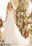 A-line wedding dress with lace bodice and soft net skirt. Shirred band at waist.