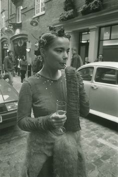 Bjork at the Sign of the Times Covent Garden shop opening, wearing mohair cardigan by Stuart Alexander and cheesecloth sequin dress by Jo Bates (now Sibling), 1994.