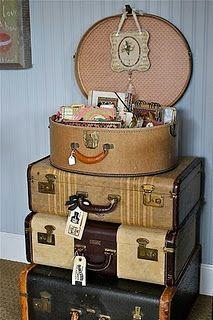 vintage suitcases for storage.   #decorativepieces