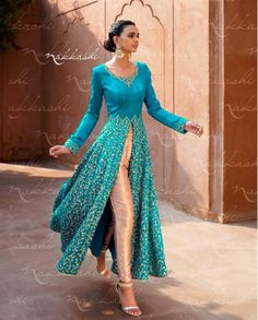 Sky blue and beige front slit suit with embroidered flare   1. Sky blue and beige silk embroidered anarkali suit2. Resham embroidery with golden gotta border on bottom3. Comes with matching santoon bottom and  chiffon dupatta4. Can be stitched upto size 42 inches
