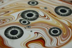Tiger Eyes marbled paper by Renato Crepaldi. #marbledpaper #marbling #renatocrepaldi #bookbinding