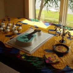 Need a party idea for a teen boy? How about a guitar theme mixed with musical notes? Combine musical note paper products, lights, and banner with...