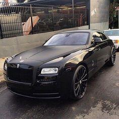 Rolls Wraith Two Tone Black (Matte Black & Black) on some black rims with dark tints