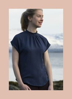 The Summer Tulip Top PDF pattern is a lovely dropped shoulder summer blouse. It's designed with a curved hem, and a small collar stand gathered to neckline.