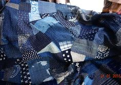 A wonderful find: a bed cover made of kasuri fabrics in boro style. Toji Temple Market, Kyoto, Japan. Indigo niche blog