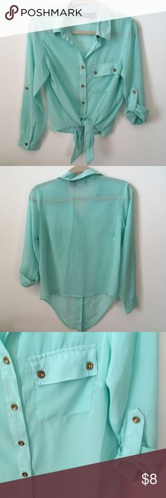 Sheer Mint Blouse Size M, true to size. Will fit loose on a S. Sheer, see-through. Gold buttons. Pocket on left side. Sleeves can be rolled and held up. Bottom front can be tied into a knot. Armpit to armpit is 18 inches wide. Shoulder to bottom, not including knot area, is 21in long. Very cool top with lots of features. Only thing wrong is it has black marks throughout as shown in pic collage, kind of unnoticeable. Otherwise, it's still a pretty good top. Worn once with leather high-waist…