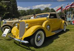 1935 yellow Lincoln Model K Convertible Roadster by LeBaron.  Sold for $242,000 US in 2014.