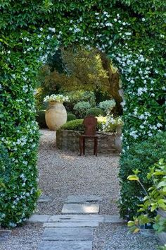 A gate in the hedge, leading to glimpses of a distant courtyard, with a chair for resting and listening to the hum of insects and a softly tinkling fountain (not in the picture, but I know it's there...)