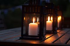 Candles in lanterns.  Pretty for a outdoors table.