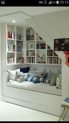 The most snug and cosy 'book nooks' to inspire the creation of your own retreat Interior , Reading Nook Ideas; Cozy Space To Relax While Enjoying A Book : Reading Nook Under Stairs With Book Collections Decor, House Design, House, Loft Conversion, Interior, Small Loft, Home Decor, Attic Rooms, House Interior
