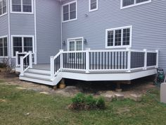 Decking: Timbertech Terrain composite decking in Silver Maple; Railings: Timbertech Radiance Rail with posts pre-wired for future lighting system; New Stairs; White PVC Trim throughout.