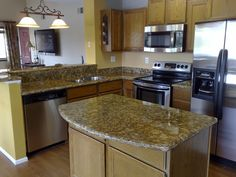 Alluring Kitchen Countertop With Soft Brown Granite Countertop ...