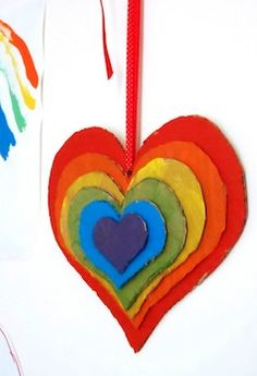 Rainbow stacked hearts from recycled cardboard.